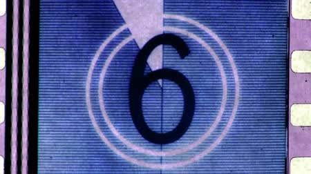 lider : universal filmacademy leader countdown, made using 35mm celluloid film strip.