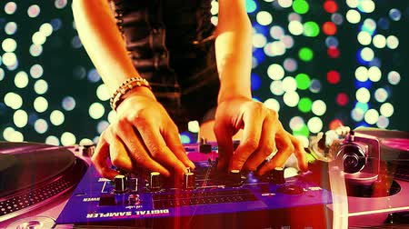 Close up of a sexy female dj dancing and playing records with disco style background Dostupné videozáznamy