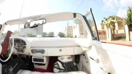 kübalı : The streets of havana, Cuba, filmed from a convertible classic car