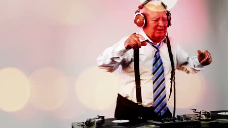 humor : a very funky elderly grandpa dj mixing records