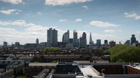 london england : beautiful fisheye timelapse of the skyline of london. Very wide shot capturing lots of buildings
