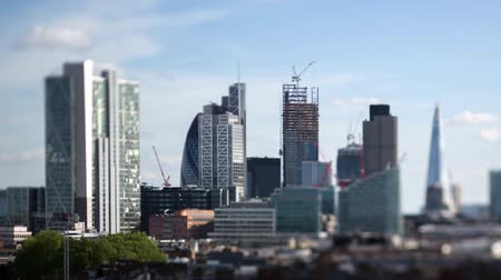 urban skyline : beautiful timelapse of the skyline of london shot with a tilt shift lens, leaving some buildings in sharp focus with a blur on the rest
