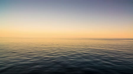 oceano : peaceful and calm shot of a gently lapping sea and nice sky