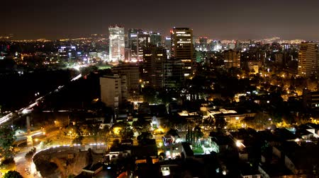urban skyline : a time-lapse of the mexico city skyline at night Stock Footage