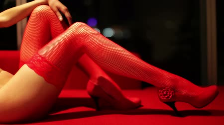 эротический : close up of a sexy womans legs in red lingerie