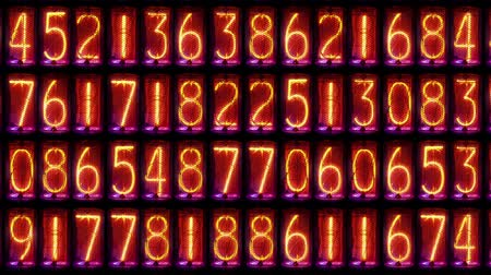 time machine : a numerical counter and number sequence filmed with an old nixie tube clock Stock Footage