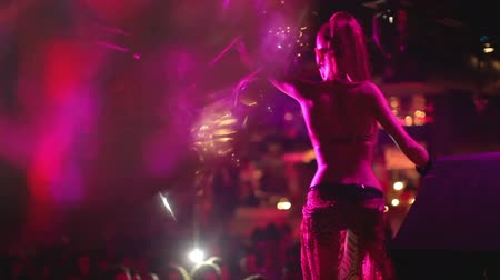 boate : abstract shot of in a nightclub, shot close to a glitterball, with a blurred gogo dancer in the background
