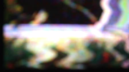 tuned : Static and electronic noise captured from an old television Stock Footage