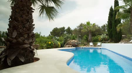 uszoda : A luxury private swimming pool surrounded by a paradise garden