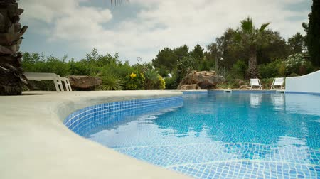 basen : A luxury private swimming pool surrounded by a paradise garden