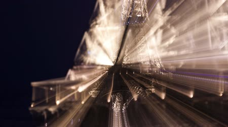 Abstract timelapse of the Eiffel tower lit up at night, in Paris