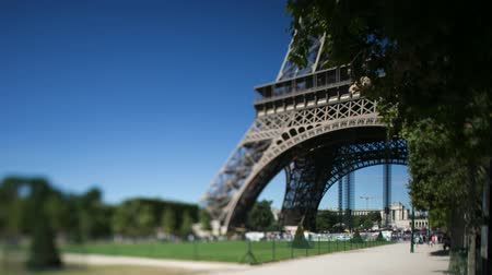 Time lapse of the Eiffel tower in Paris shot on a summer day shot from ground level