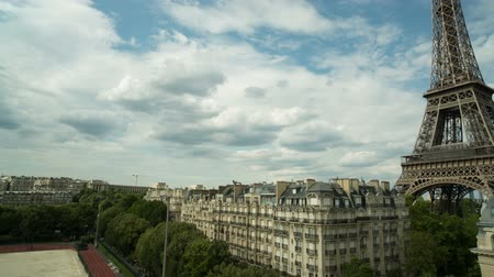The Eiffel tower in Paris with lovely summer clouds