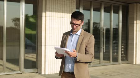verifying : Male businessman reading documents. Stock Footage