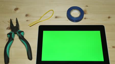 alicate : Hand tools, pliers and a tablet with a green display for your content.