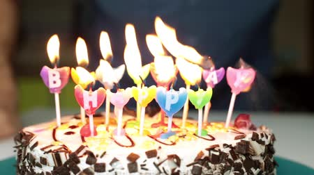 bafat : A man blows out candles on the cake. Birthday, holiday, cake with candles.