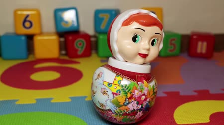 колебание : Russian national toy Roly-poly toy. Childrens room.