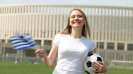 greek flag : Football fan with the flag of Greece. Woman with a Greek flag and a soccer ball.