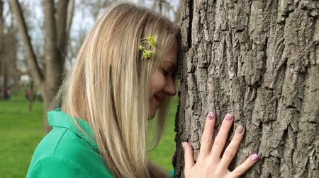 tree stump : Nature and harmony. A young woman touches a tree. Stock Footage