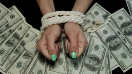kötés : Money and womans bound hands. Concept of financial independence.