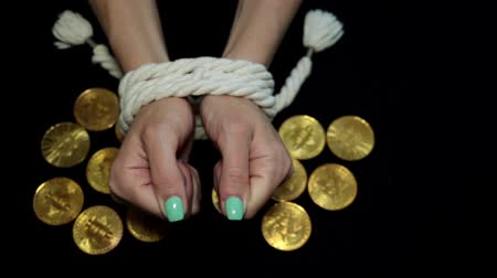 налог : Bitcoins and bound hands of a woman. Financial slavery, excitement, debts. Стоковые видеозаписи