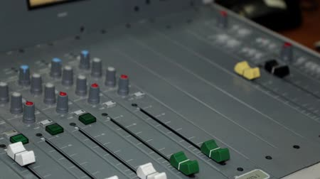 switch : A mans hand and a mixer console in a recording studio or on a radio station. Stock Footage