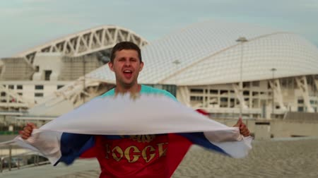 fisht : A man is a football fan with the Russian flag. A fan with the flag of Russia. Stock Footage