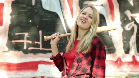 homicide : Attractive woman with a baseball bat. Stock Footage