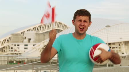 league : Football fan with the flag of Canada Stock Footage