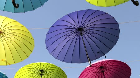 parasol : Street of colored umbrellas. Multicolored umbrellas soar in the sky. Stock Footage