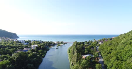 aerialphotography : Aerial survey, the mouth of the river. A tranquil river flows into the sea.