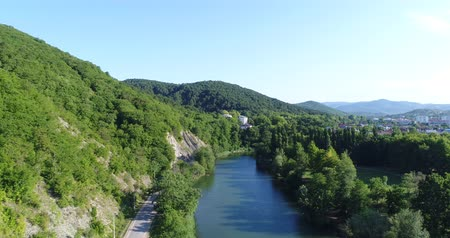 aerialphotography : Calm river, forest and green hill. Aerial photography, panorama of the river.