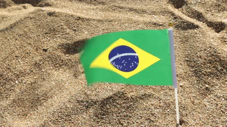 brazil : Flag of Brazil on a sandy beach.
