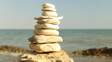 stacked rock : Pyramid of stones the background of the sea. Relax and rest. Stock Footage