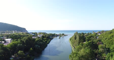 aerialphotography : Aerial view - the river in the sea. The mouth of the river.