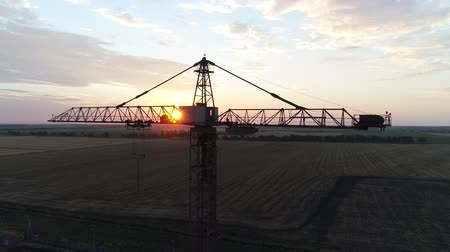 aerialphotography : building industrial crane against the background of the sun Stock Footage