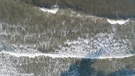 dark island : Aerial view, waves and wild seashore. Slow motion.
