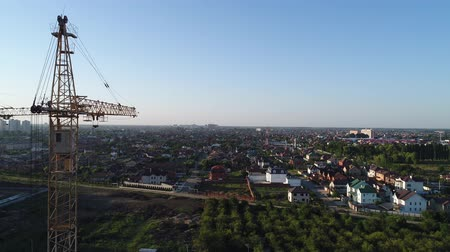 aerialphotography : Aerial: construction cranes in the background of the city.