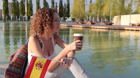 happiness symbol : Young woman with a Spanish flag.