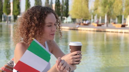 happiness symbol : Young woman with the flag of Italy.