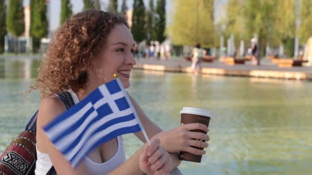 happiness symbol : Young woman with the flag of Greece.