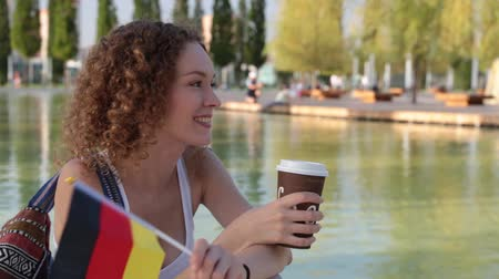 happiness symbol : Young woman with the flag of Germany. Stock Footage