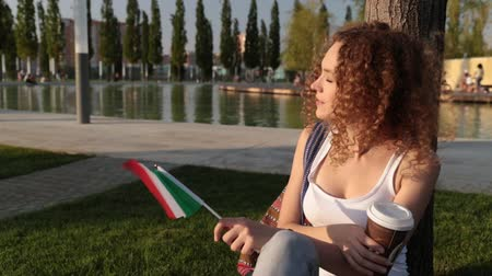 happiness symbol : Beautiful female tourist with the flag of Italy.