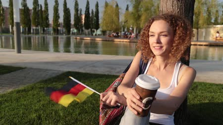happiness symbol : Beautiful female tourist with the flag of Germany.