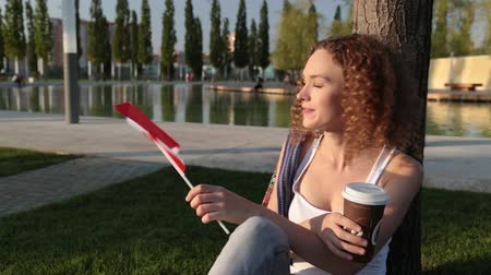 happiness symbol : Beautiful female tourist with the flag of Canada. Stock Footage