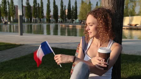 happiness symbol : Beautiful female tourist with the flag of France.