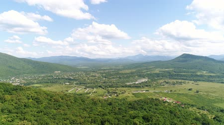 aerialphotography : Aerial view, green valley, farm and mountains. Stock Footage