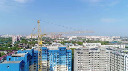 emel : Aerial view, building crane and building.