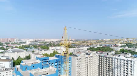 emel : Lifting construction crane, aerial view. Stock mozgókép