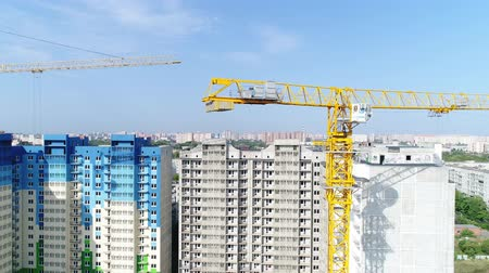 emel : Construction crane. City, building crane, aerial view. Stock mozgókép